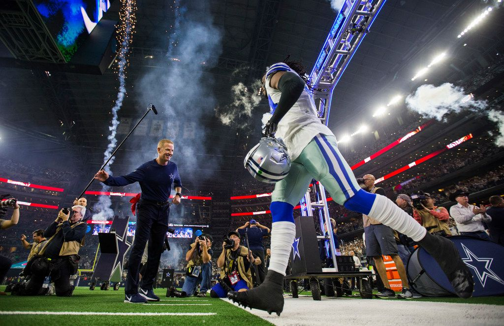 Dallas Cowboys middle linebacker Jaylon Smith (54) enters the field with head coach Jason Garrett before an NFL playoff game between the Dallas Cowboys and the Seattle Seahawks on Saturday, January 5, 2019 at AT&T Stadium in Arlington, Texas.