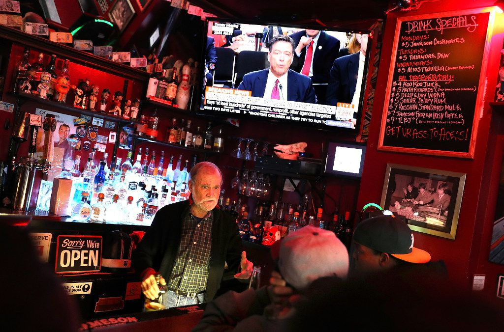 SAN FRANCISCO, CA - JUNE 08:  A bartender helps customers as a television broadcast of former FBI Director James Comey testify before the Senate Intelligence Committee plays in the background on June 8, 2017 in San Francisco, United States. People across the country are flocking to bars and restaurants to watch former FBI director as he testifies before the Senate Intelligence Committee about his conversations with U.S. President Donald Trump.  (Photo by Justin Sullivan/Getty Images)