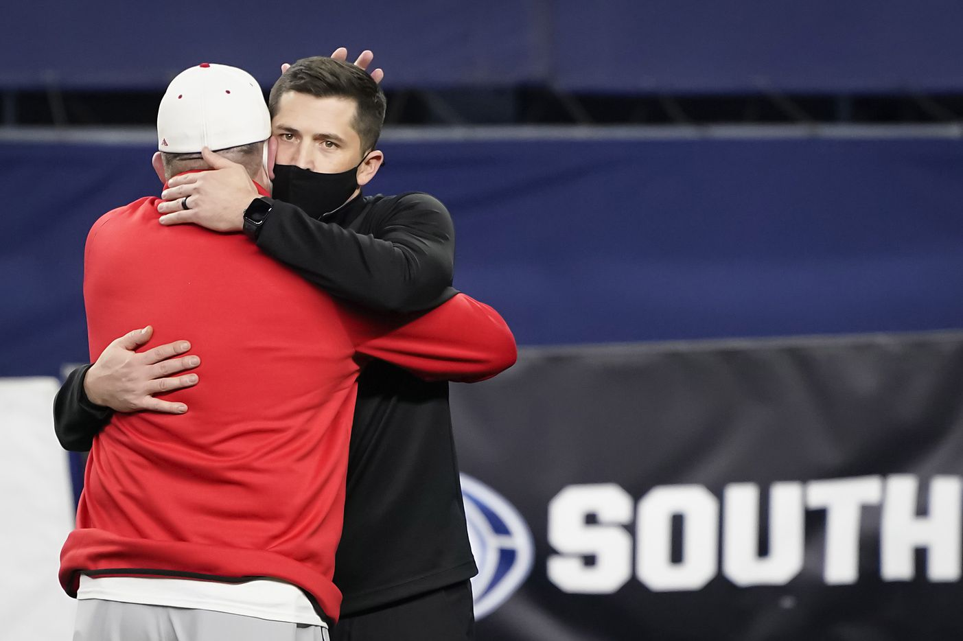 Southlake Carroll head coach Riley Dodge (facing) hugs his father, Austin Westlake head coach Todd Dodge, before the two faced in the Class 6A Division I state football championship game at AT&T Stadium on Saturday, Jan. 16, 2021, in Arlington, Texas.