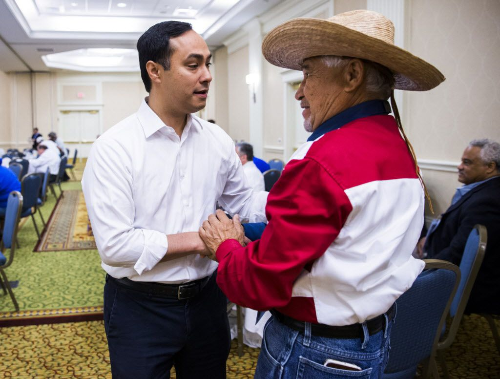 U.S. Representative Joaquin Castro of San Antonio greets Fidel Acevedo, delegate from Austin, at the Texas delegation breakfast during day four of the Democratic National Convention on Tuesday, July 27, 2016 at the Philadelphia Airport Marriott in Philadelphia, Pennsylvania.
