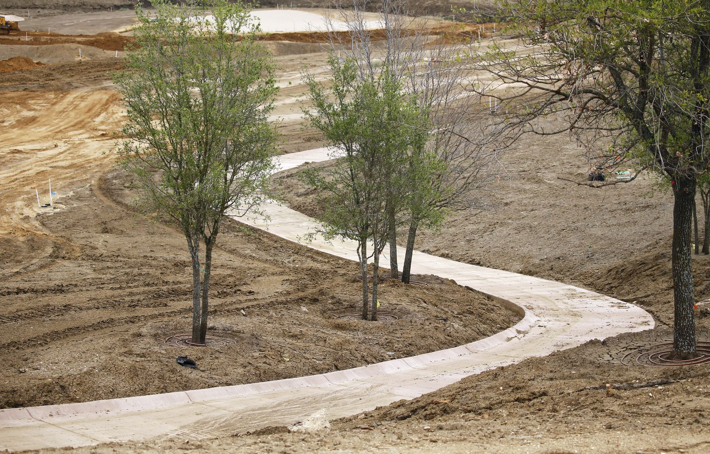 Concrete paths along the course on the West Course designed by Beau Welling at PGA Frisco in Frisco, Texas, on Wednesday, May 20, 2020. The $520 million project is a mixed-use development that will be home to the PGA of America headquarters and two championship golf courses.