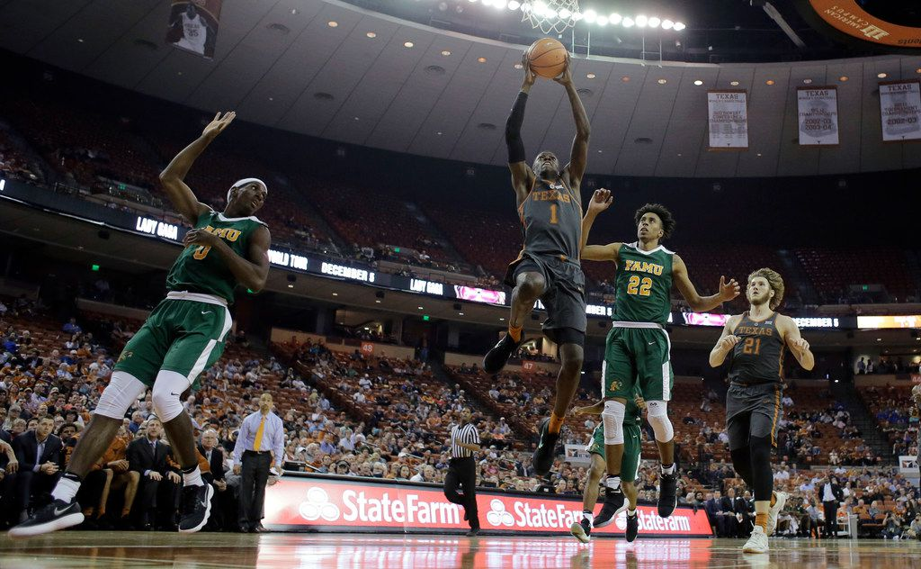 Texas guard Andrew Jones (1) drives to the basket past Florida A&M guard Marcus Barham (22) during the second half of an NCAA college basketball game, Wednesday, Nov. 29, 2017, in Austin, Texas. Texas won 82-58. (AP Photo/Eric Gay)