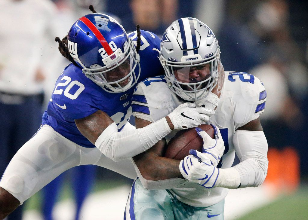 New York Giants cornerback Janoris Jenkins (20) rides Dallas Cowboys running back Ezekiel Elliott (21) to the turf during the second quarter at AT&T Stadium in Arlington, Texas, Sunday, September 8, 2019. (Tom Fox/The Dallas Morning News)