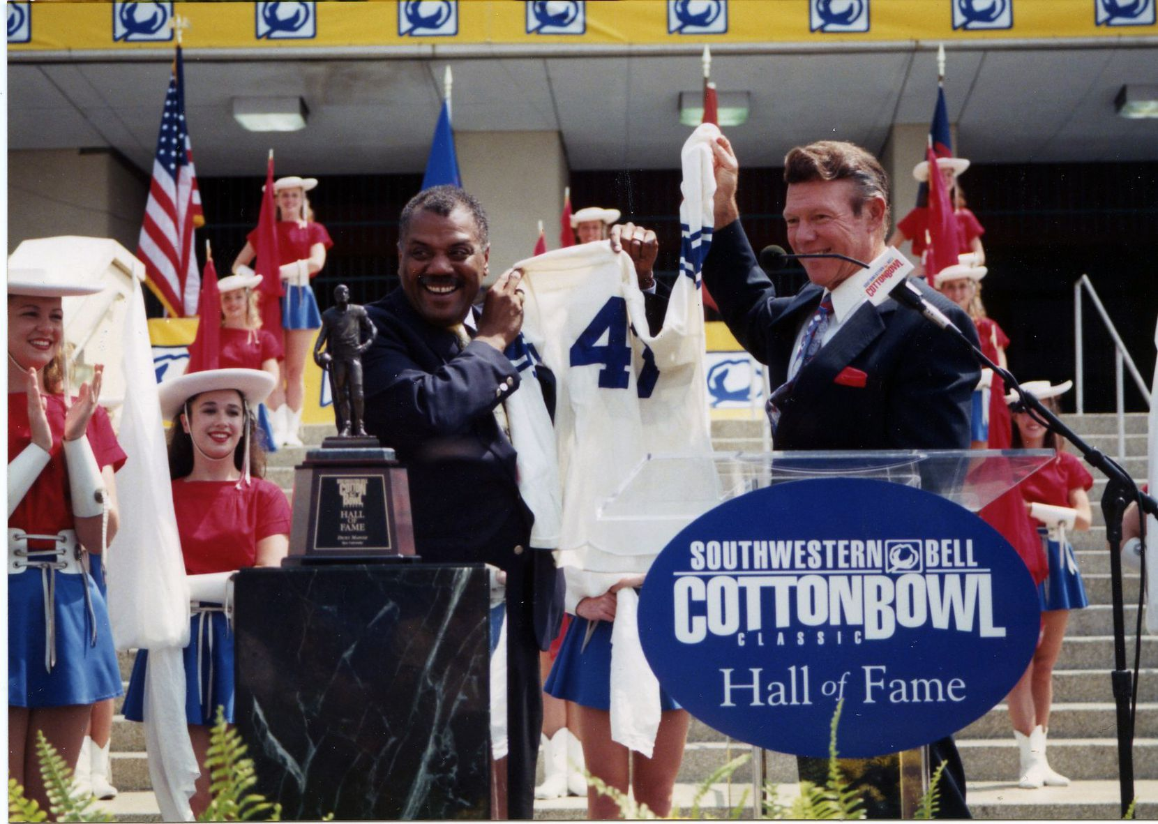 Two-time Cotton Bowl Chairman Fred McClure at the 1998 Cotton Bowl Hall of Fame Induction Ceremony with Rice running back Dicky Maegle. The Classic's internship program was recently named in honor of McClure.