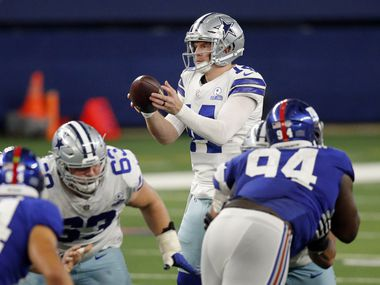 Dallas Cowboys quarterback Andy Dalton (14) takes a fourth quarter snap against the New York Giants at AT&T Stadium Stadium in Arlington, Texas, Sunday, October 11, 2020.