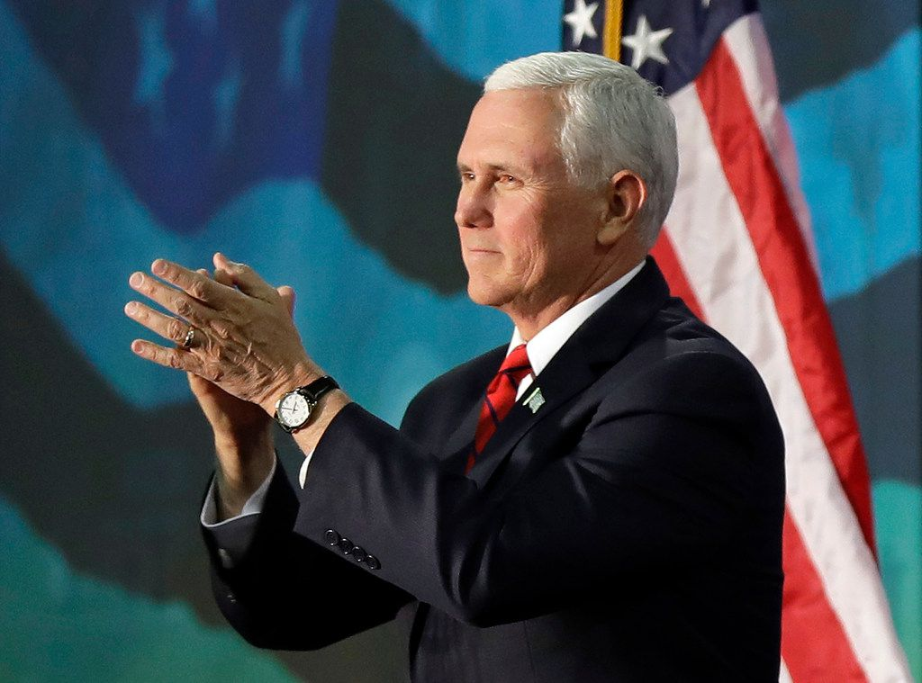 Vice President Mike Pence applauds to the crowd after speaking at an event on tax policy in Charlotte, N.C., Friday, April 20, 2018. (AP Photo/Chuck Burton)