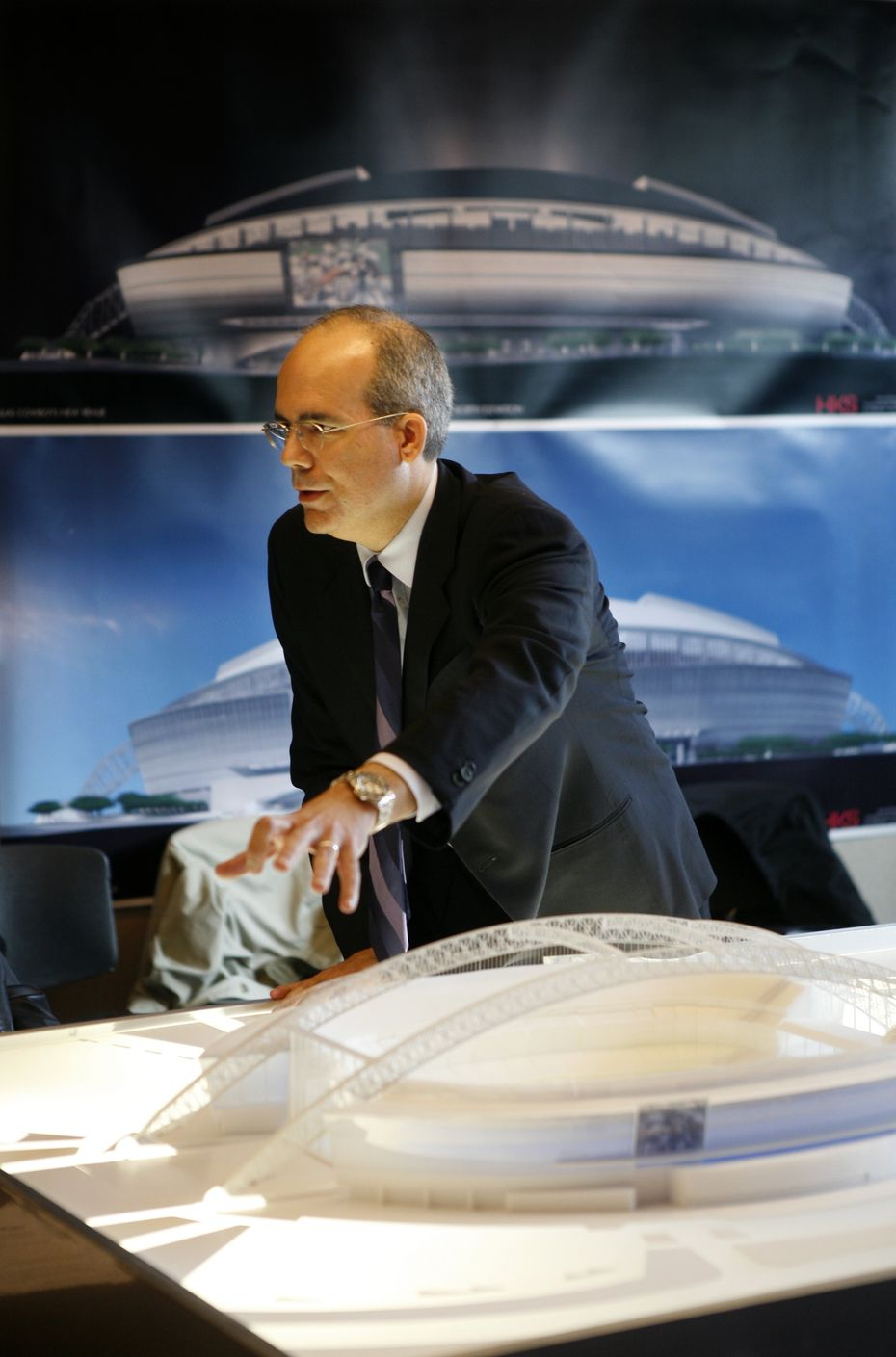 A 2006 file photo shows Bryan Trubey with a model of what became AT&T Stadium.
