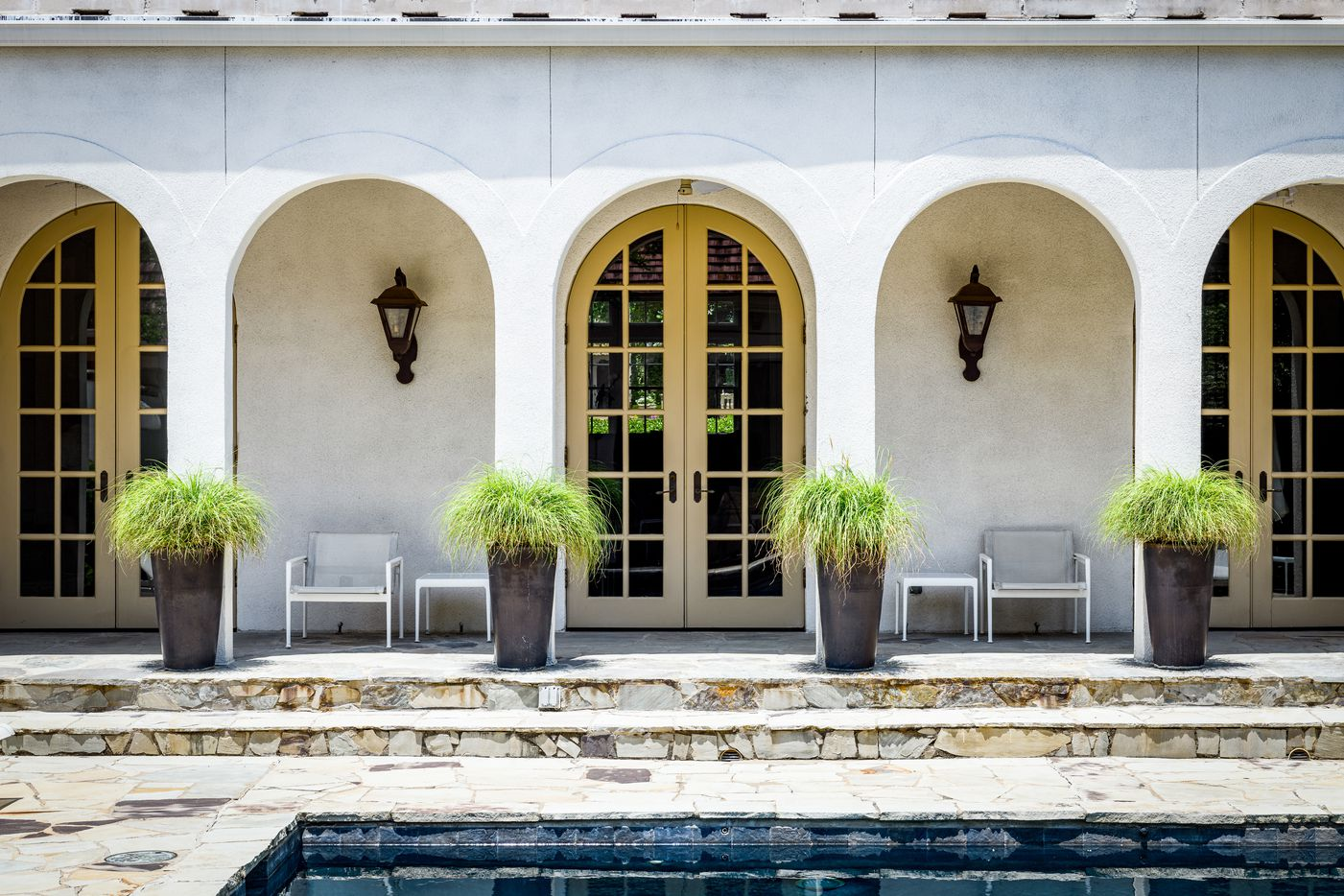 Three sets of French doors overlook the home's pool.