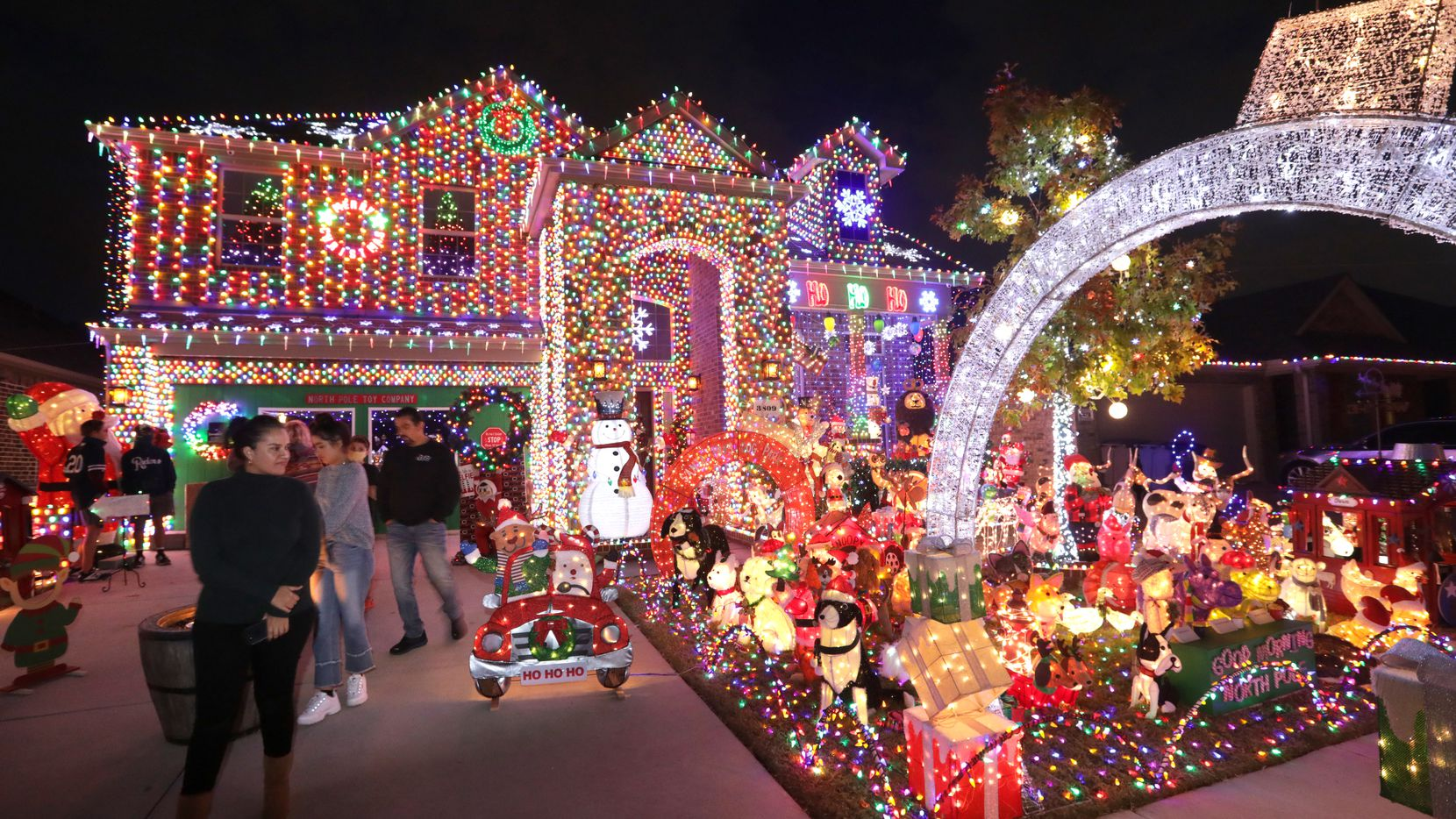 Visitors take in the Burkman family's holiday lights at their Frisco home.