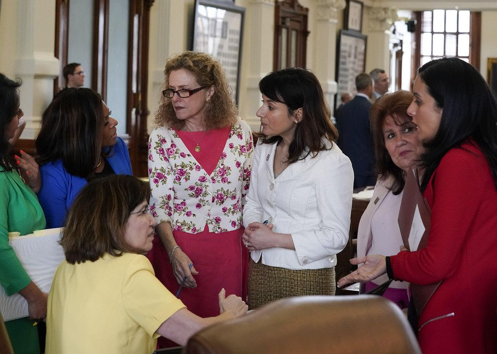 From second from left, state Reps. Nicole Collier, Donna Howard and Gina Hinojosa,  and Victoria Neave, right, all Democrats, plot strategy with other lawmakers on the House floor during a debate on Senate Bill 22 on Friday, May 17, 2019.