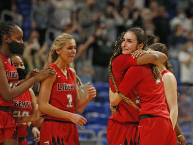 Frisco Liberty Maya Jain #24 hugs Frisco Liberty Jazzy Owens-Barnett #30 at the end of the game. Frisco Liberty vs. Cedar Park in girls basketball Class 5A state championship game on Wednesday, March 11, 2021 at the Alamodome.
