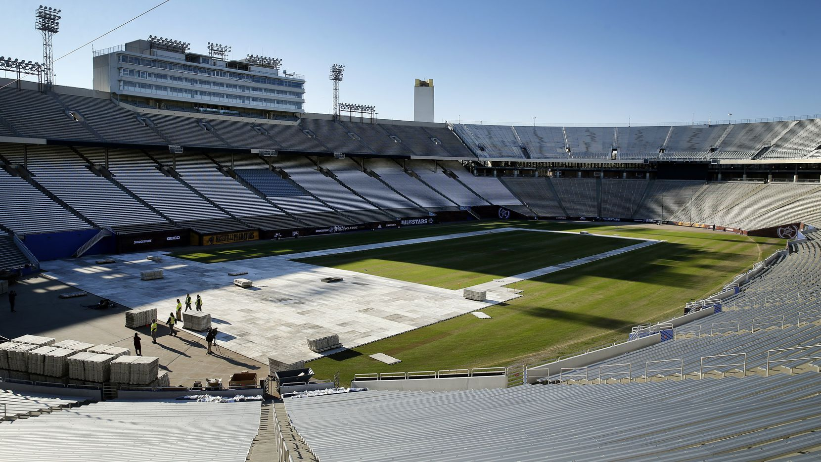 The plastic decking is going down on the Cotton Bowl field in preparation for the New Year's Day Winter Classic hockey game at Fair Park in Dallas, Tuesday, December 17, 2019. The annual game will pit the Dallas Stars against the Nashville Predators. (Tom Fox/The Dallas Morning News)