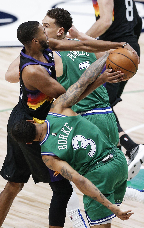 Dallas Mavericks guard Trey Burke (3) battles Phoenix Suns forward Mikal Bridges, center, for a the ball during the second half of an NBA basketball game in Dallas, Saturday, January 30, 2021. (Brandon Wade/Special Contributor)