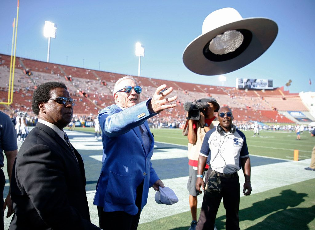 Dallas Cowboys owner and general manager Jerry Jones throws a hat back to a fan after signing it before a game against the Los Angeles Rams at Los Angeles Memorial Coliseum in Los Angeles, California on Saturday, August 12, 2017. (Vernon Bryant/The Dallas Morning News)