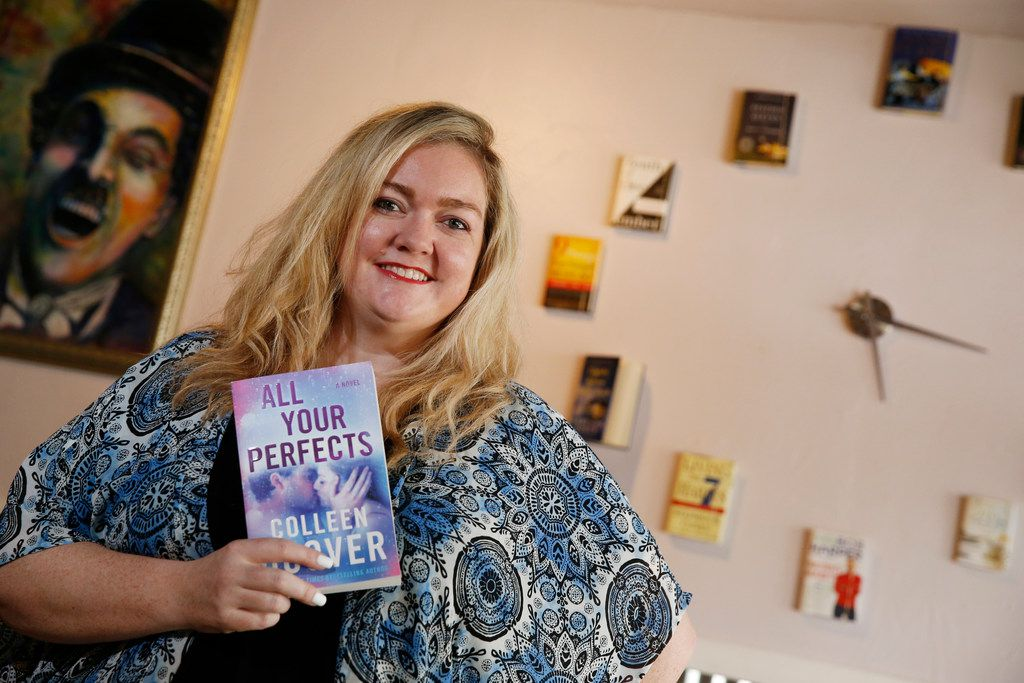 Author Colleen Hoover holds her book All Your Perfects at her bookstore, The Bookworm Box, in Sulphur Springs on July 11.