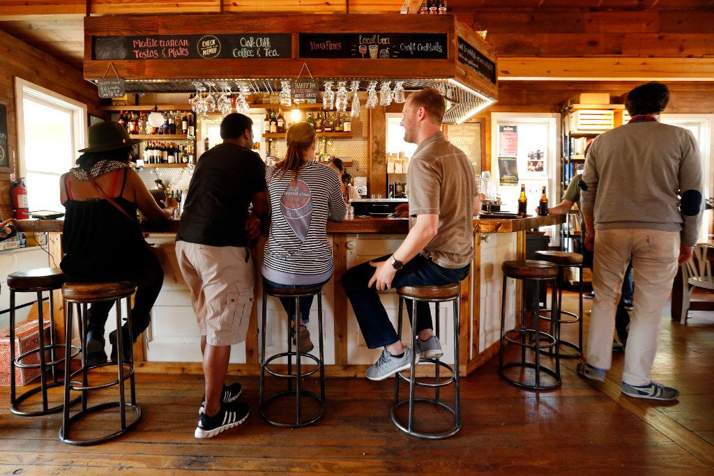 People take a seat at the bar for conversation and drinks at The Wild Detectives bookstore in the Bishop Arts area of Dallas, Saturday, March 25, 2017. The bookstore/ bar/coffee bar is celebrating it's third anniversary. (Tom Fox/The Dallas Morning News)