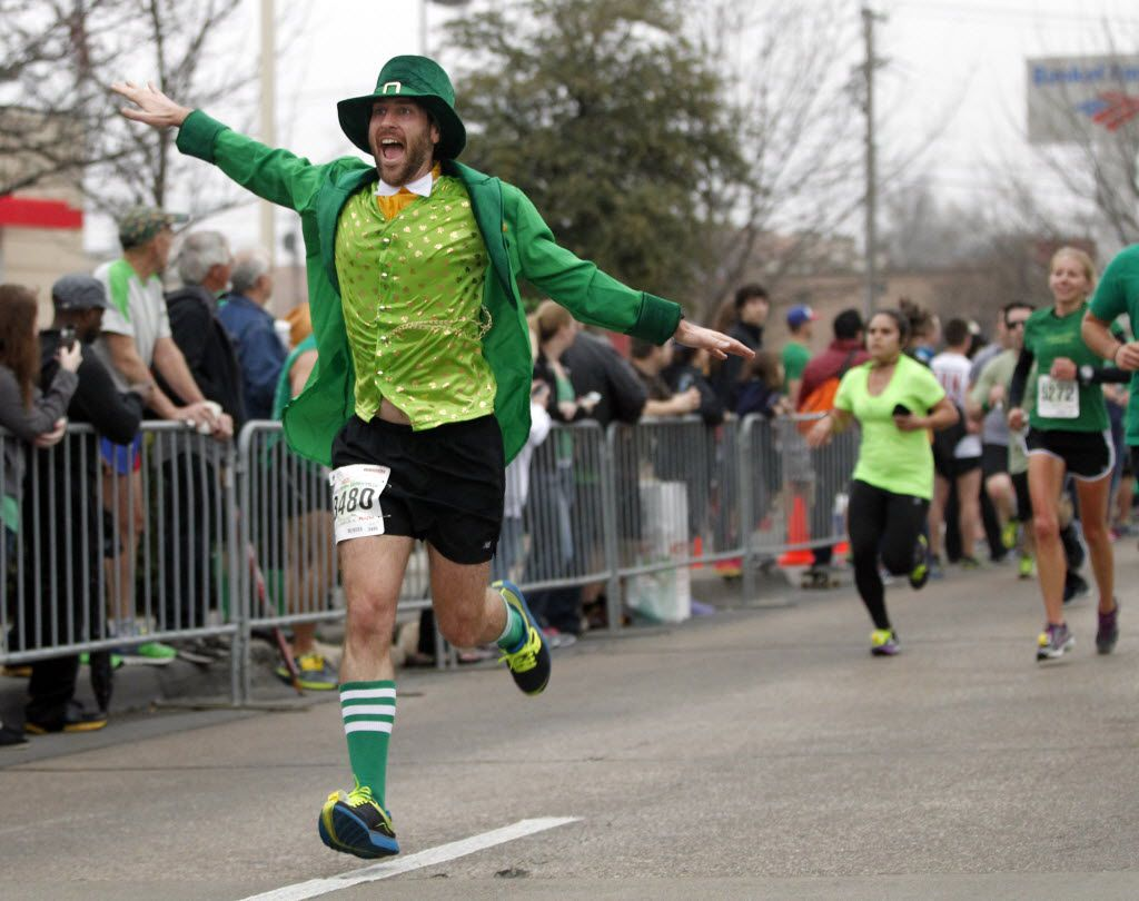 Matthew Kingore runs the final stretch during the St. Paddy's Day Dash Down Greenville 5k in 2014.