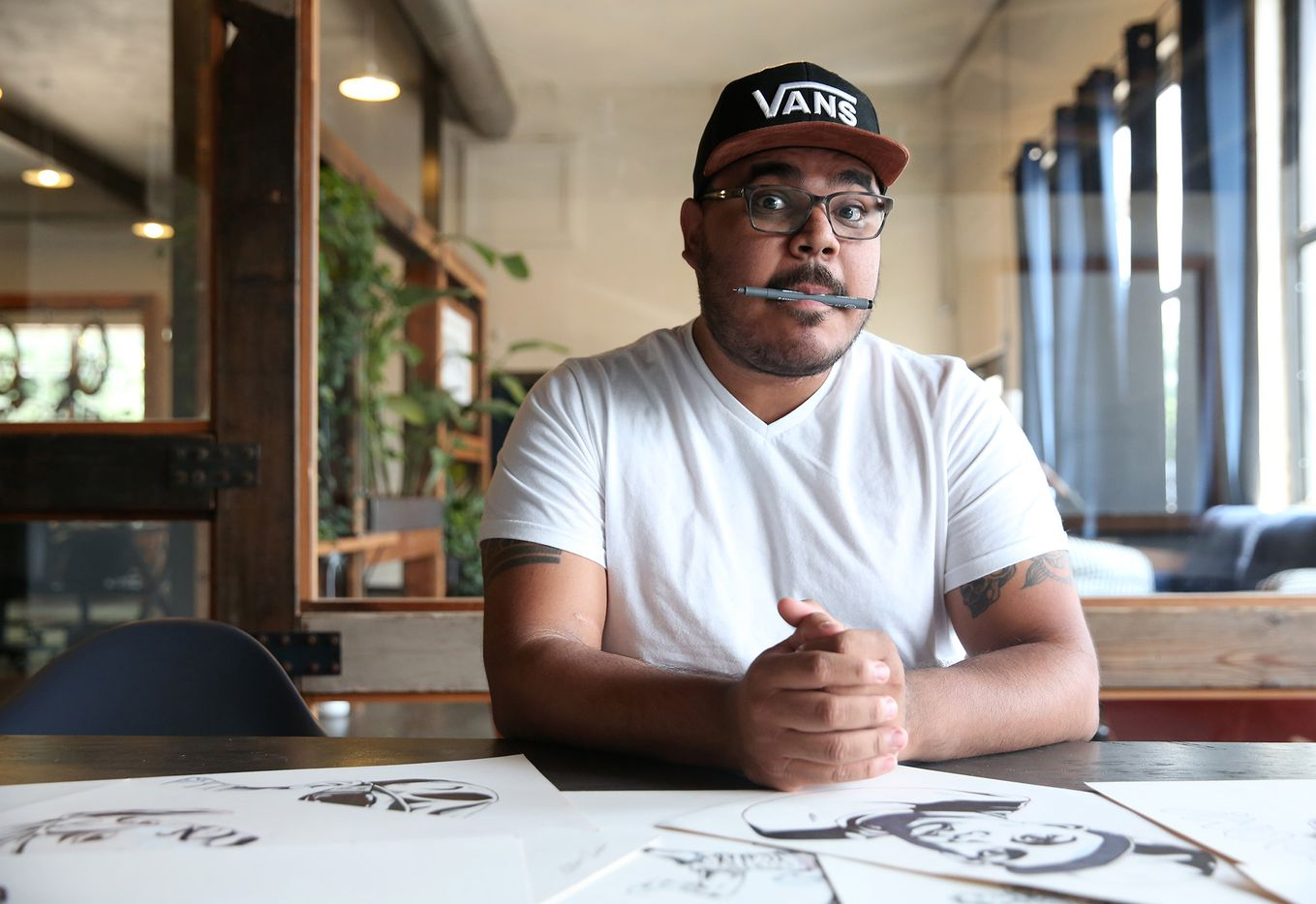 Arturo Torres, a local Dallas artist, poses for a photograph at Common Desk in Oak Cliff on May 18.