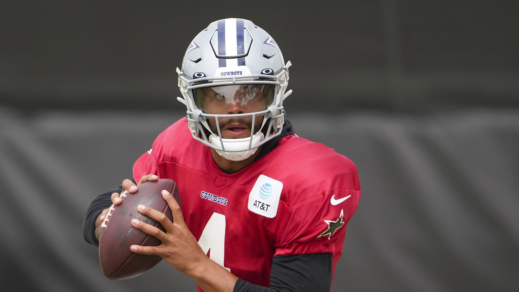 Dallas Cowboys quarterback Dak Prescott (4) runs a drill during a practice at training camp on Saturday, July 31, 2021, in Oxnard, Calif.