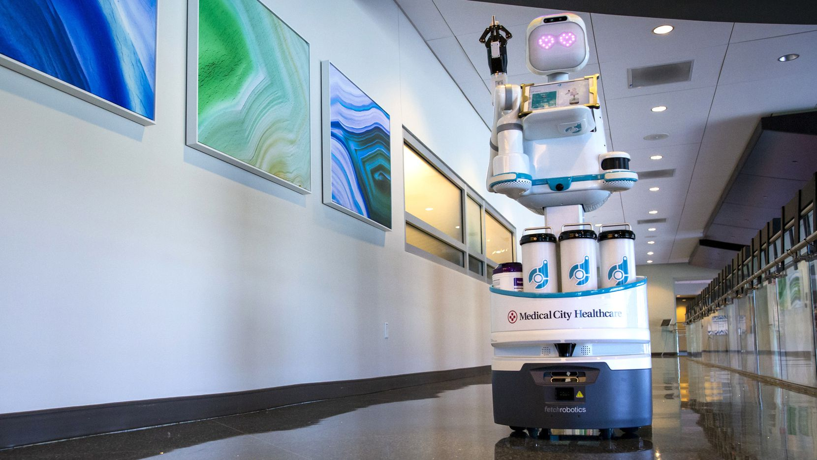 Moxi, a care assistant robot, demonstrates a specimen transfer at the Medical City Heart and Spine Hospital in Dallas on Friday, Feb. 14, 2020. The hospital is the first to use Austin-based Diligent Robotics robots as medical assistants.
