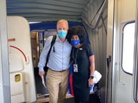 American Airlines CEO Doug Parker and Southwest Airlines flight attendant JacqueRae Hill pose outside a Southwest Airlines 737 after landing in Panama City, Fla.