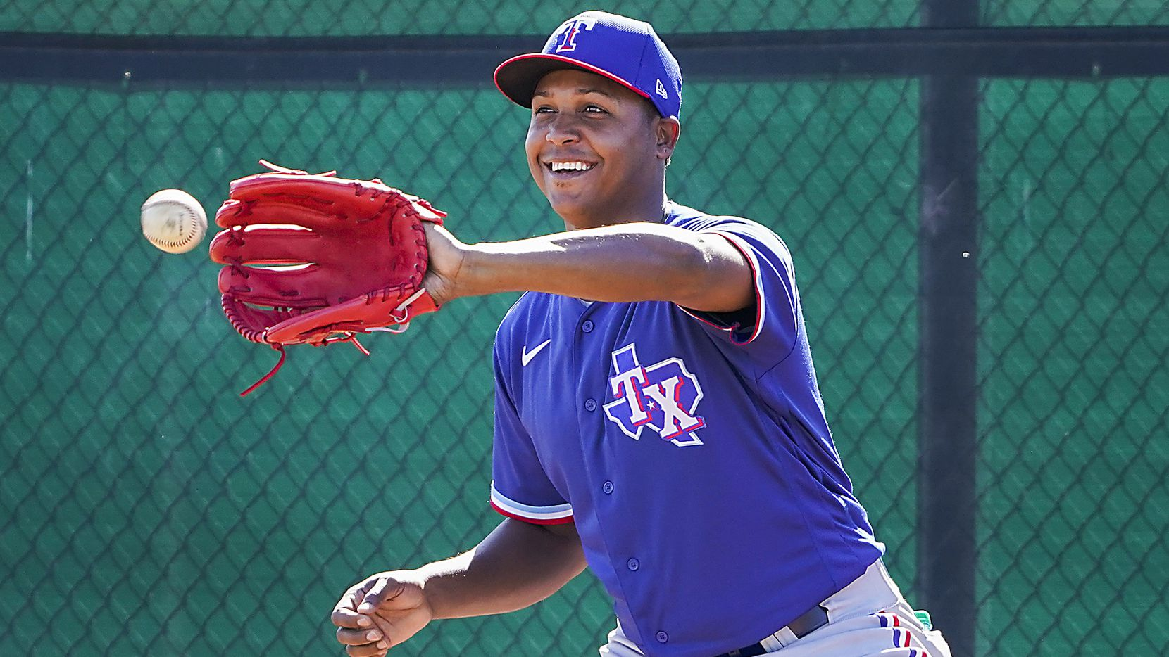 Texas Rangers pitcher Jose Leclerc participates in a fielding drill during a spring training workout at the team's training facility on Saturday, Feb. 15, 2020, in Surprise, Ariz.