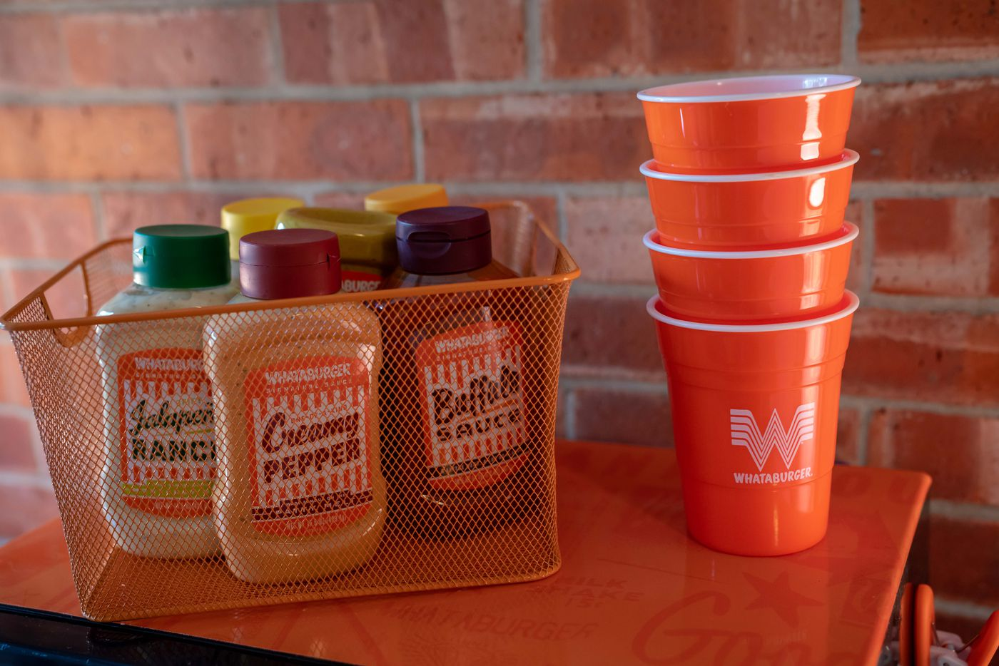 Enrique Alcoreza's Whataburger-themed dorm room -- which came free from the Texas burger brand -- includes a basket of sauces, of course.