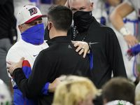 Austin Westlake head coach Todd Dodge hugs his son, Southlake Carroll head coach Riley Dodge, after a 52-34 Westlake victory in the Class 6A Division I state football championship game at AT&T Stadium on Saturday, Jan. 16, 2021, in Arlington, Texas.