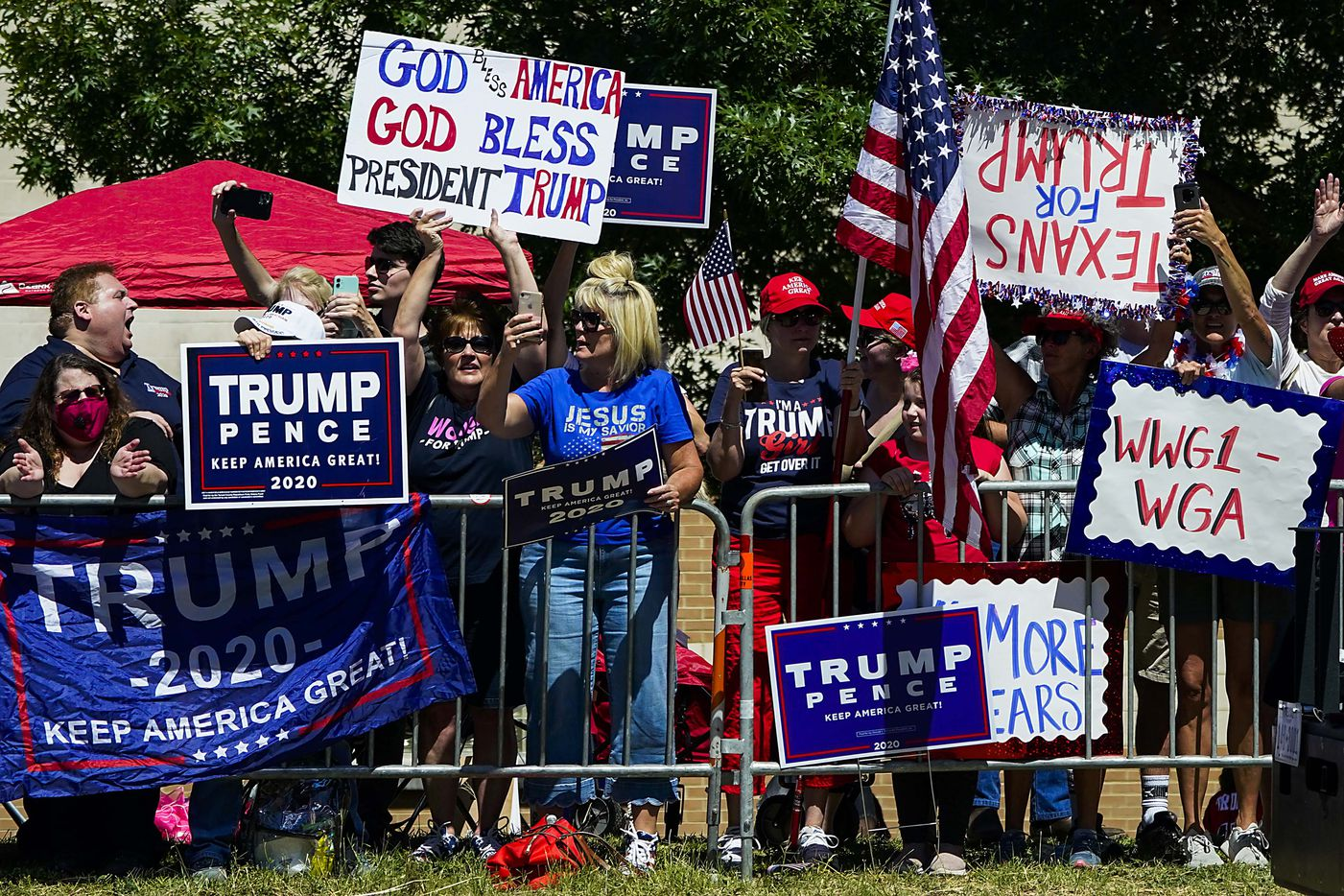 Supporters gather on the road near the church as President Donald TrumpÕs motorcade moves from Dallas Love Field Airport en route to Gateway Church Dallas Campus for a roundtable conversation about race relations and policing  on Thursday, June 11, 2020, in Dallas. (Smiley N. Pool/The Dallas Morning News)
