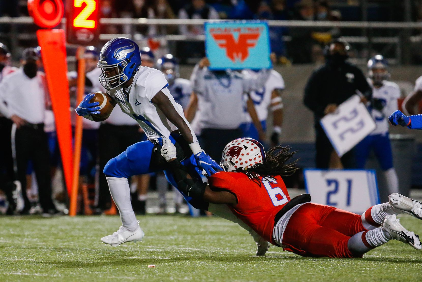 Fort Worth Nolan's Irene Ngabonziza (7) is grabbed by Parish Episcopal's Kenneth Borders (6) during the fourth quarter of a TAPPS Division I state football championship game against  at Panther Stadium in Waco on Saturday, Dec. 12, 2020. (Juan Figueroa/ The Dallas Morning News)