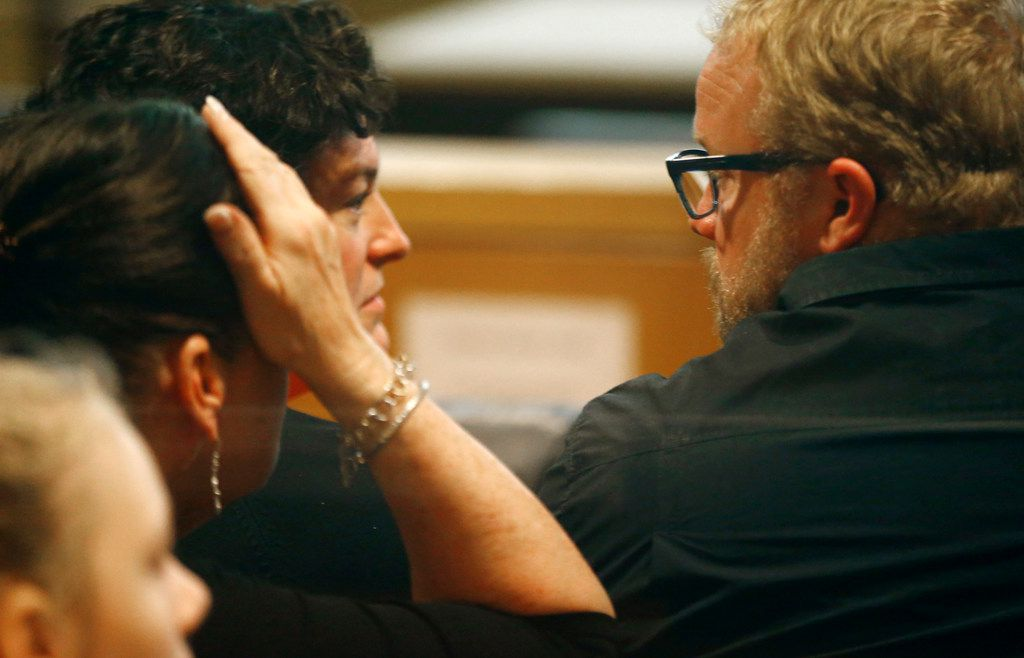 Jim Hastings (right) talked to family members before the verdict was delivered in the case against his daughter's killer.