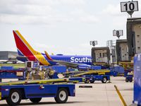 A Southwest Airlines 737 is parked at a gate at Dallas Love Field in Dallas on May 19.