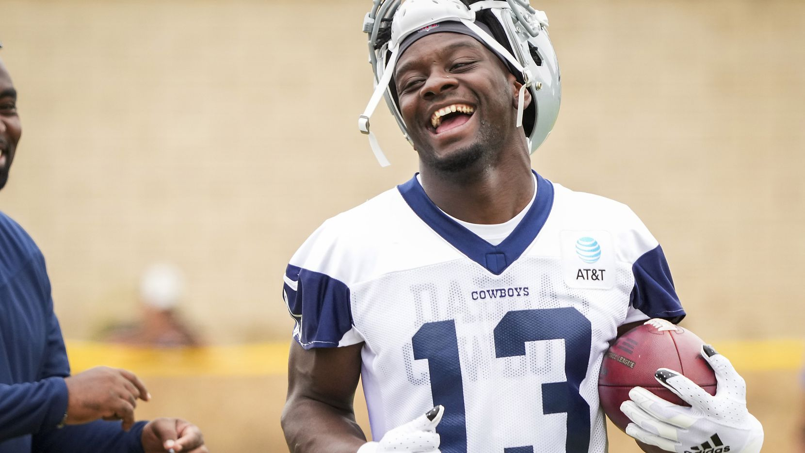 Dallas Cowboys wide receiver Michael Gallup smiles on the sidelines during a practice at training camp on Sunday, July 25, 2021, in Oxnard, Calif.