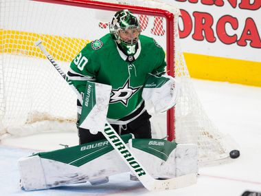 Dallas Stars goaltender Ben Bishop (30) makes a save on a shot by the Buffalo Sabres' Henri Jokiharju during the third period on Thursday, Jan. 16, 2020, at the American Airlines Center in Dallas. The Sabres won, 4-1.