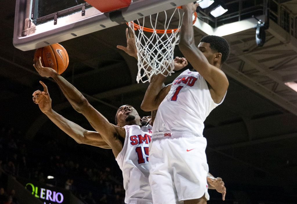 Southern Methodist Mustangs forward Isiaha Mike (15) struggles and fails to control the ball for a basket in the second half of an NCAA basketball game between the SMU Mustangs and the University of Central Florida Knights at Moody Coliseum in University Park, Texas, on Wednesday, Jan. 8, 2020.