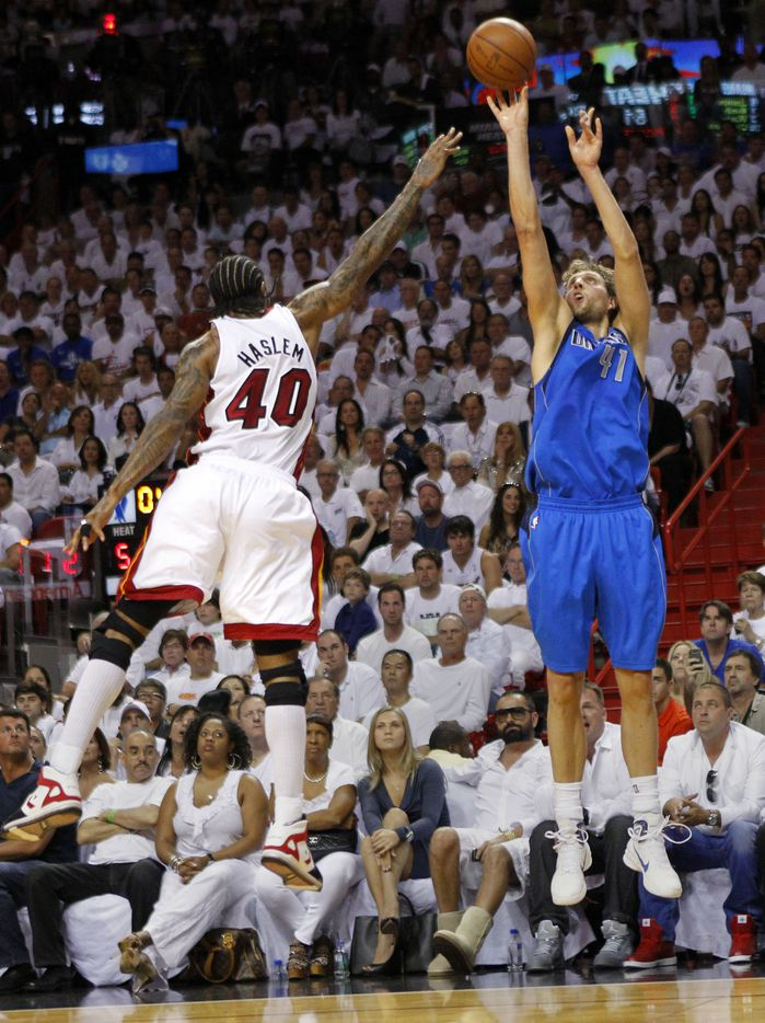 Dallas Mavericks power forward Dirk Nowitzki (41) puts up a three pointer against Miami Heat power forward Udonis Haslem (40) during the second quarter of play in game six of the NBA Finals at American Airlines Arena Sunday, June 12, 2011 in Miami   (Tom Fox/The Dallas Morning News)