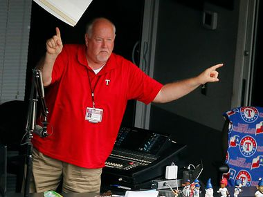"""Texas Rangers announcer Chuck Morgan leads the crowd in a song of """"Take Me Out To The Ballgame"""" during the seventh inning stretch against the Toronto Blue Jays at Globe Life Park in Arlington, Thursday, June 22, 2017."""