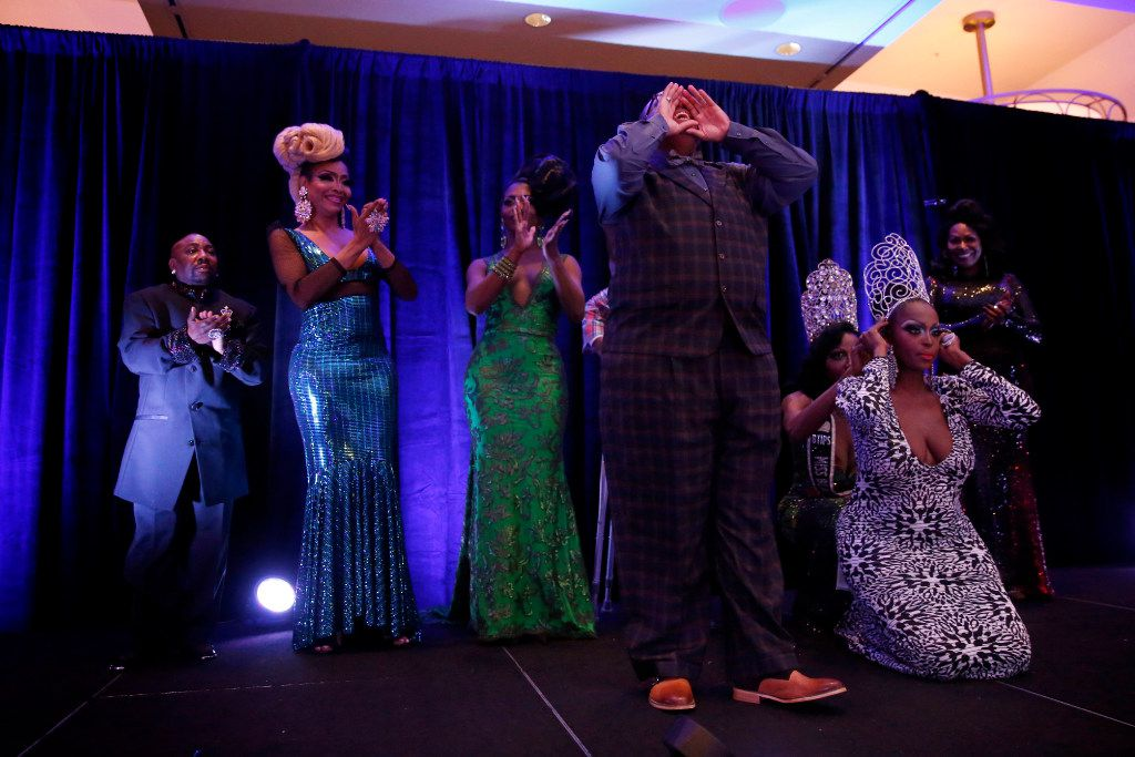 Trenton Johnson yells to the crowd upon winning the Mr. Black Trans International title in the Mr. and Miss Black Trans International Pageant at the Dallas/Addison Marriott Quorum by the Galleria in Dallas on Thursday.