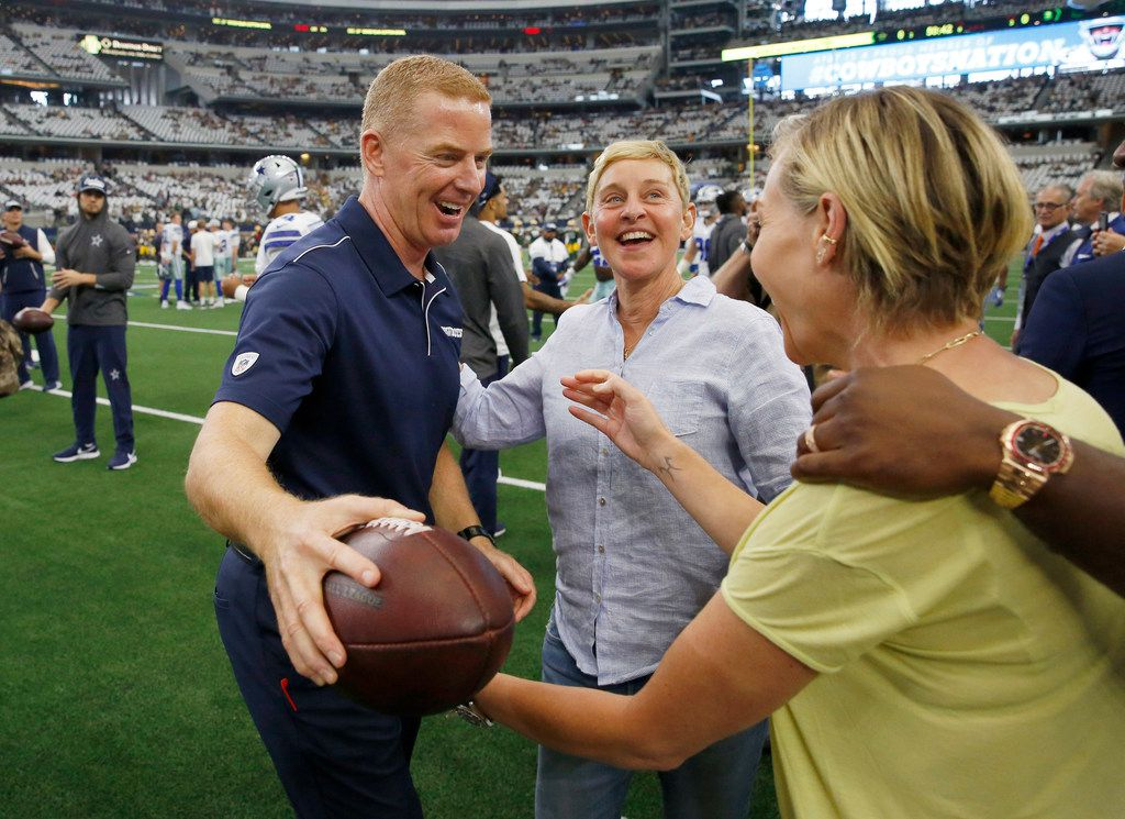 Dallas Cowboys head coach Jason Garrett hugs Portia de Rossi as her spouse Ellen DeGeneres introduces her before a game against the Green Bay Packers at AT&T Stadium in Arlington, Texas on Sunday, October 6, 2019.