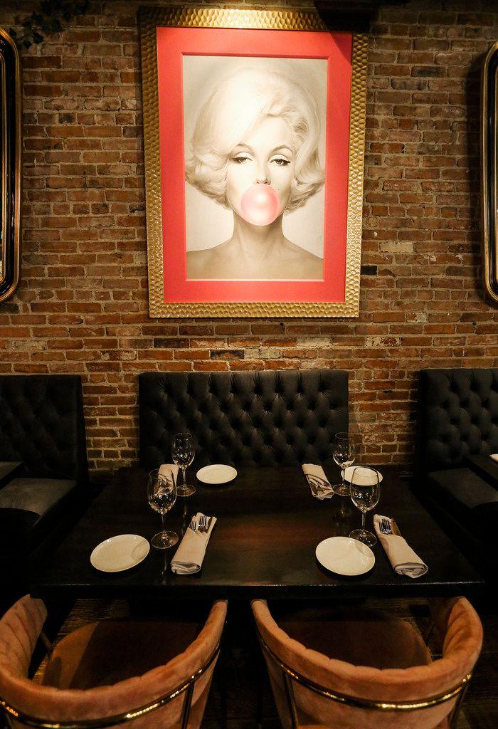 New restaurant Felix Culpa in Dallas has a wall full of art, including this print of Marilyn Monroe.
