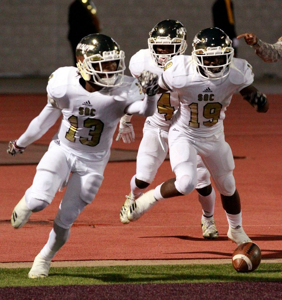 South Oak Cliff Rapheal Williams (19) races from the field with teammates Donjaz Dunn (13) and Zecqurie Cannon Grant Fields (4), after scoring a touchdown during a high school football game against Kimball at Kincaide Stadium in Dallas on Saturday, November 2, 2018. (John F. Rhodes / Special Contributor)