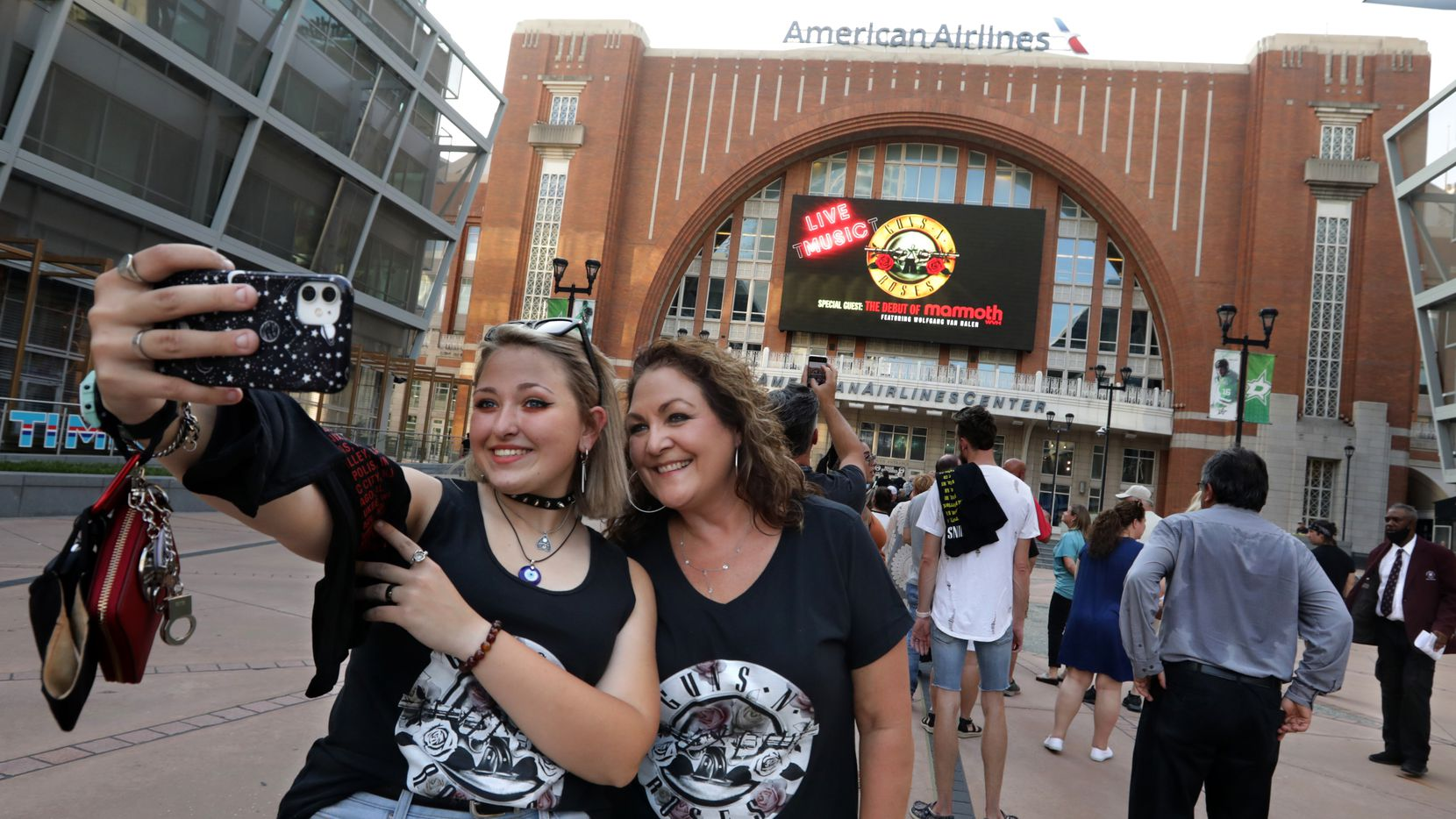 Emma Bradley, left, and Stacy Bradley take a selfie as fans line up to see Guns N' Roses at American Airlines Center on Wednesday.