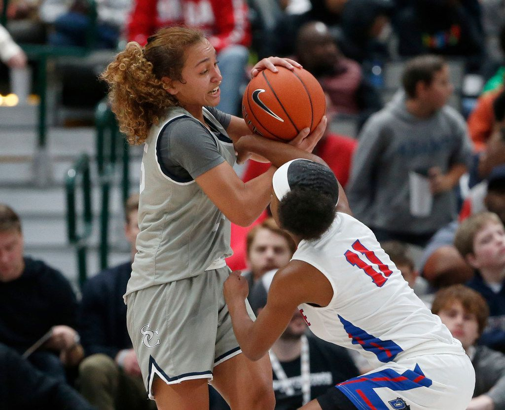 Duncanvilles Tristen Taylor (11) tries to get the ball from Sierra Canyon's Ashley  Chevalier (25) during their high school basketball game during the Thanksgiving  Hoopfest in Dallas, Tx, Saturday, Nov. 30, 2019. (Michael Ainsworth)