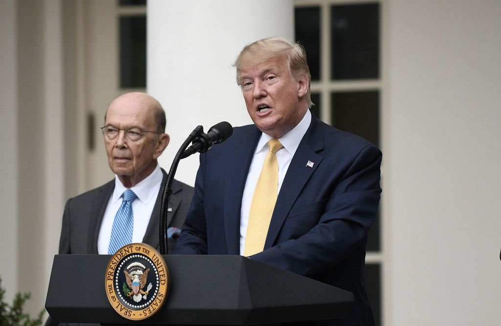 President Donald Trump speaks during a news conference about U.S. citizenship status for the upcoming 2020 census in the Rose Garden at the White House on Thursday, July 11, 2019, in Washington, D.C. At left is Secretary of Commerce Wilbur Ross.