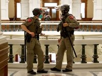 State police officers guard the state capitol following the House opening ceremony for the 87th Texas Legislature at the Texas Capitol building in Austin, Texas, on Tuesday, Jan. 12, 2021.