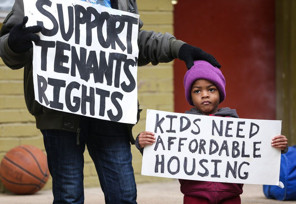 Alfred Lee, 3, (right) stands by his grandmother, Dionne Lee, during a news conference at Bryan Song Apartments on Tuesday, Jan. 15, in Old East Dallas. Lee received an eviction notice on December 10 to be out of her apartment by February 10.