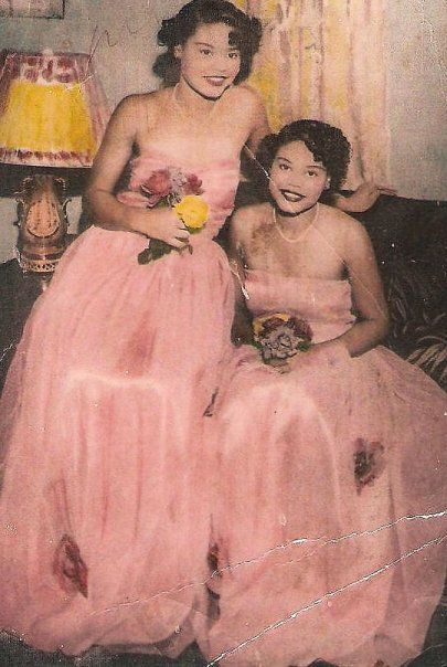 Ina Bell Daniels McGee and Nina Nell Daniels Wheeler in their younger years, dressed for a formal event.