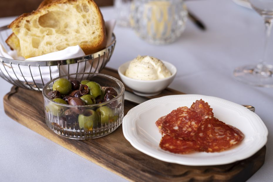 All diners get focaccia, top, with whipped ricotta, olives and sliced meat at Monarch.
