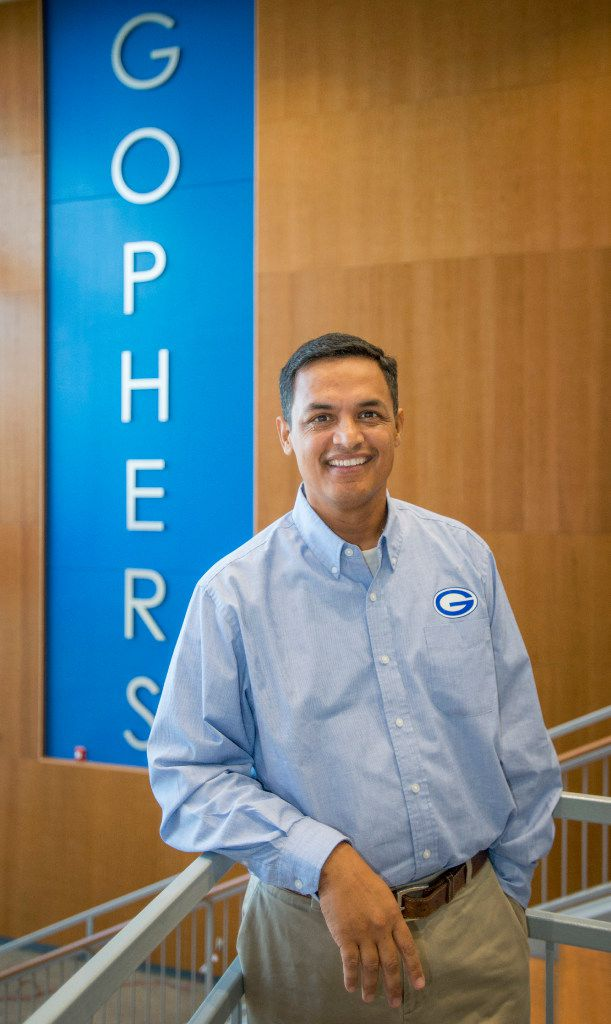 Grand Prairie High School Principal Lorimer Arendse poses in the foyer of the new four-story learning tower that will serve senior students and a few juniors.