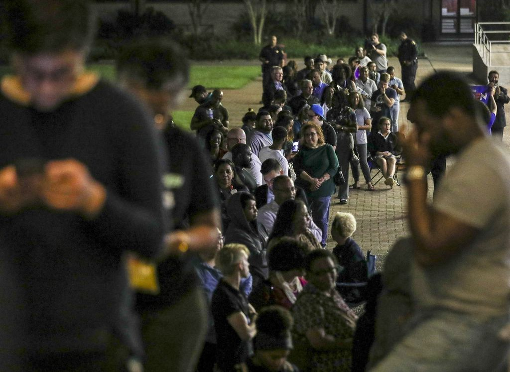 People wait in line to vote Tuesday at Texas Southern University in Houston. . Democrats have sued the state, saying the elimination of straight-ticket voting could equal even longer lines in urban areas in November. (Jon Shapley/Houston Chronicle via AP)